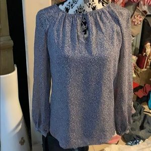 Tory Burch  beautiful blouse size 2 fits a small.